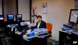 FILE PHOTO - In this photo taken on March 14, 2017, Pakistani journalist Hamid Mir sits in his office in Islamabad, Pakistan.