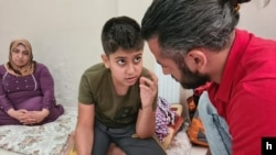 Ibrahim, 12, shows a VOA reporter a map on his phone of his family's five attempts to travel to Greece as refugees on Aug. 25, 2020 in Istanbul. (VOA/Heather Murdock)