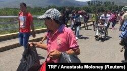 FILE - Venezuelan migrants cross the Simon Bolivar bridge from Venezuela to the Colombian city of Cucuta, May 31, 2018.