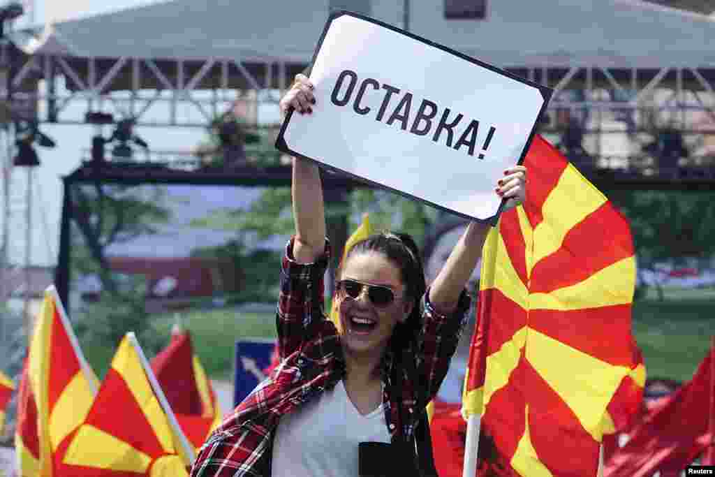 "A woman raises a sign reading ""resignation"" during an anti-government demonstration in Skopje, Macedonia, May 17, 2015."
