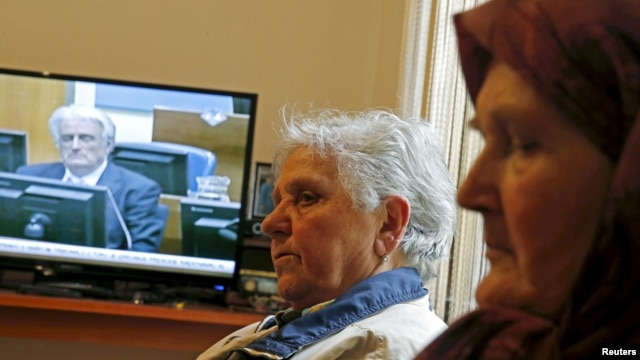 Sajma Smajlovic (R) and Vasva Smajlovic watch on television the genocide trial of former Bosnian Serb leader Radovan Karadzic over the 1995 Srebrenica massacre as he appears before the U.N. tribunal in The Hague, as they gather at Smajlovic's house in Potocari near Srebrenica March 24, 2016.