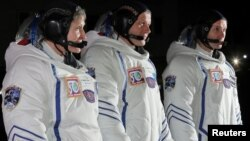 International Space Station crew members, from left, American Peggy Whitson, Russian Oleg Novitskiy and Frenchman Thomas Pesquet are seen before the launch of the Soyuz spacecraft at the Baikonur cosmodrome, Kazakhstan, Nov. 17, 2016.