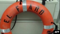 FILE - A life ring was recovered by the Coast Guard from the El Faro cargo ship, which sank Oct. 1. Salvage operations were suspended Monday.