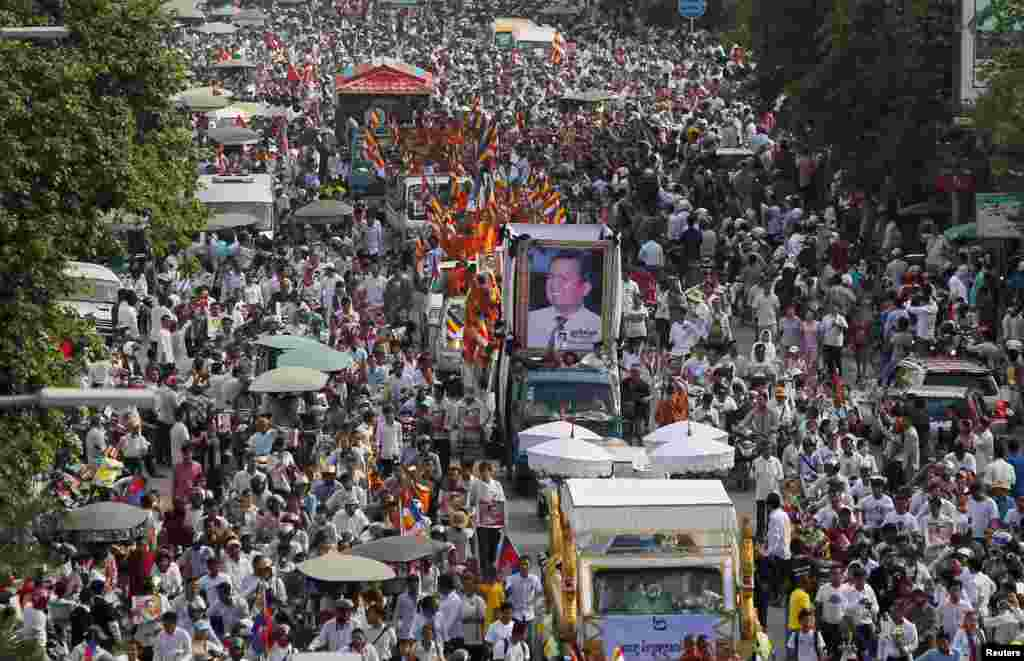 "Tens of thousands of people attend a funeral procession to carry the body of Kem Ley, an anti-government figure and the head of a grassroots advocacy group ""Khmer for Khmer"", to his hometown, in Phnom Penh, Cambodia. Kem Ley was shot dead on July 10."
