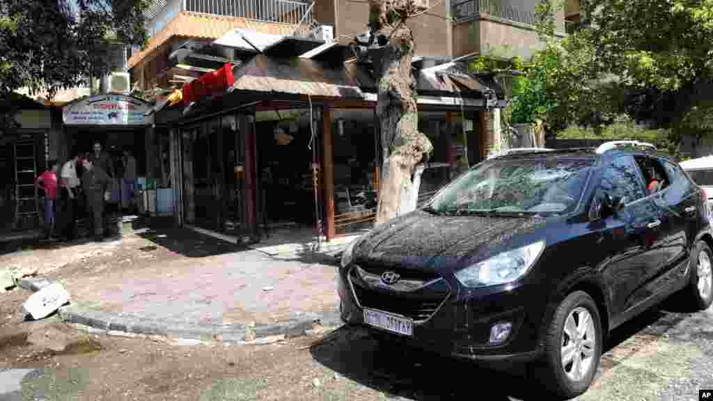 Syrian official news agency (SANA) photo shows a building damaged by what SANA said was a missile in Damascus, Sept. 2, 2013.