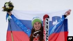 Women's giant slalom gold medal winner Slovenia's Tina Maze of Slovenia poses for photographers on the podium at the Sochi 2014 Winter Olympics, Feb. 18, 2014.