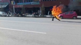 Citizen journalist image shows Tibetan man self-immolating in Labrang, China, October 23, 2012.