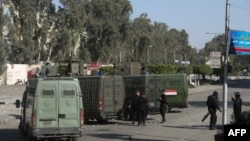 FILE - Egyptian riot policemen surround the entrance of al-Azhar university.