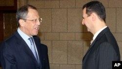 图为阿萨德总统与俄罗斯外长拉夫罗夫2008年资料照