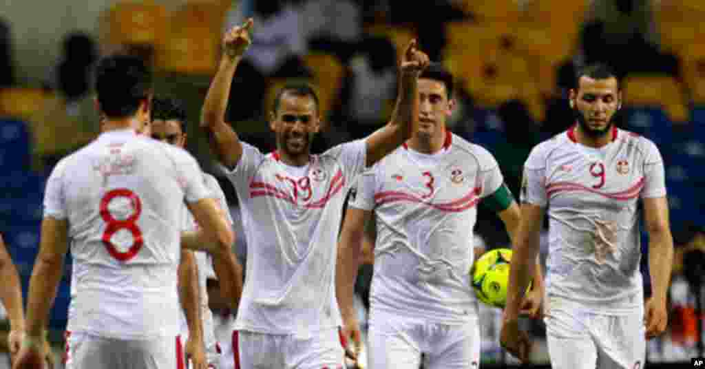 Tunisia's Saber celebrates his first goal with teammates during their African Cup of Nations soccer match against Morocco in LibrevilleTunisia's Saber celebrates his first goal with teammates during their African Cup of Nations soccer match against Morocc