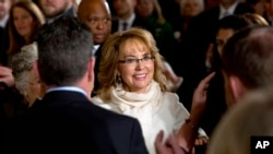 People applaud former Arizona Rep. Gabby Giffords as she arrives at the White House, to hear President Obama speak about steps to reduce gun violence, Jan. 5, 2016.