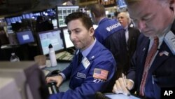 Traders work on the floor at the New York Stock Exchange in New York, January 2, 2013.