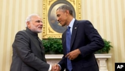 President Barack Obama shakes hands with Indian Prime Minister Narendra Modi, Tuesday, Sept. 30, 2014, in the Oval Office of the White House in Washington.
