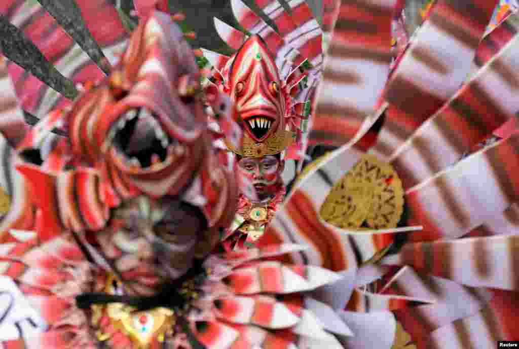Balinese artists dressed in decorative costumes take part in the Maritime Festival at Pandawa Beach on the resort island of Bali, Indonesia.