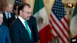 Mexico's Foreign Secretary Luis Videgaray walks to his chair during the U.S.-Mexico bilateral meeting on disrupting transnational criminal organizations at State Department in Washington, Dec. 14, 2017.