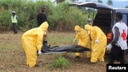 FILE - Health workers carry the body of an Ebola virus victim in the Waterloo district of Freetown, Sierra Leone.