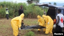FILE: A team carries the body of an Ebola victim in Freetown, Sierra Leone. At least 70 percent of the country's burials are conducted safely, the World Health Organization reports.