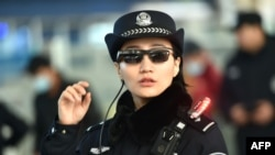 This file picture taken on February 5, 2018 shows a police officer wearing a pair of smartglasses with a facial recognition system at Zhengzhou East Railway Station in Zhengzhou in China's central Henan province. (AFP)
