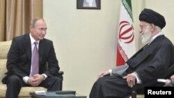 Russia's President Vladimir Putin, left, meets with Iran's Supreme Leader Ayatollah Ali Khamenei in Tehran, Iran, Nov. 23, 2015.