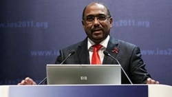 Michel Sidibe, head of the United Nations AIDS agency, speaks in Rome at a conference on HIV/AIDS