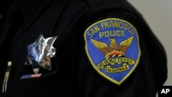 A patch and badge are seen on the uniform of a San Francisco police officer during a news conference Friday, April 29, 2016, in San Francisco.