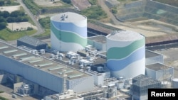 FILE - Kyushu Electric Power Co.'s Sendai nuclear power plant in Kagoshima prefecture, Japan, pictured in August 2015, reported no abnormalities after an earthquake was recorded May 10, 2019.