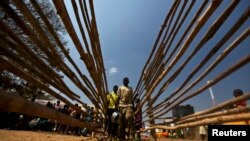 South Sudanese refugees line up for food at the Tzaipi refugee camp in Adjumani, 471 km (293 miles) north of Uganda's capital Kampala, Jan. 17, 2014.