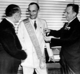 German diplomats award Henry Ford, center, Nazi Germany's highest honor for foreigners, the Grand Cross of the German Eagle, in Detroit on July 30, 1938