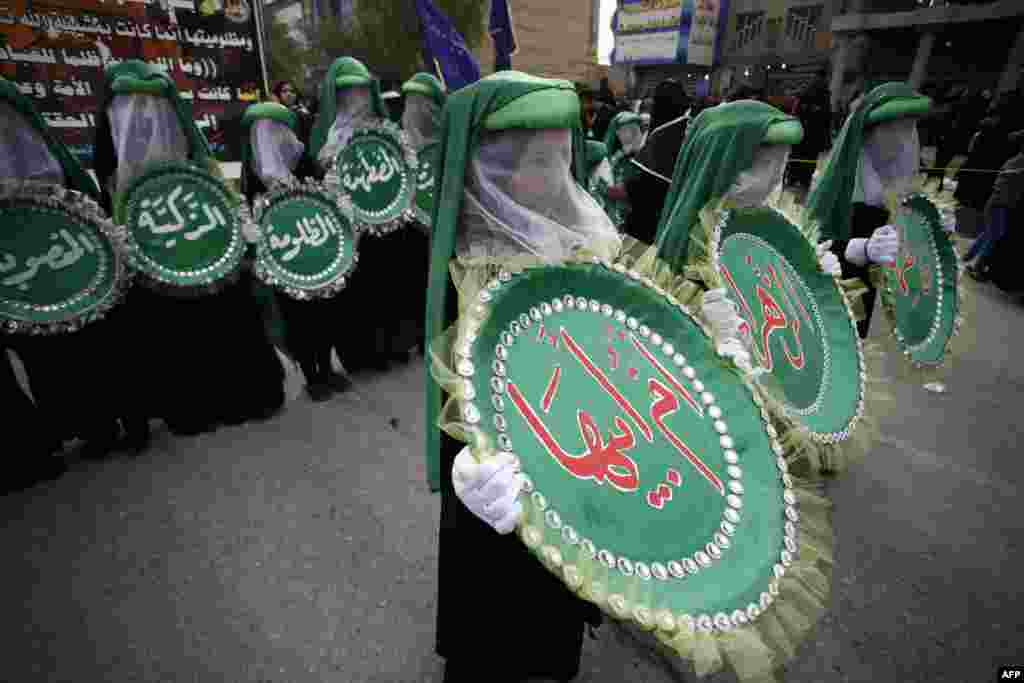 Supporters of senior Iraqi Shiite cleric Ayatollah Muhammad al-Yaqubi attend a religious ceremony to commemorate the death anniversary of Fatima, daughter of Prophet Mohammed, in the holy city of Najaf, Iraq.