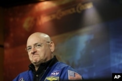 FILE - NASA astronaut Scott Kelly listens to a question about his scheduled mission aboard the International Space Station during a briefing at Johnson Space Center in Houston, Dec. 5, 2012.