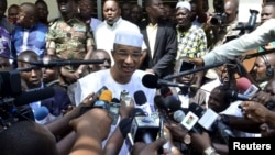 Benin Presidential candidate Lionel Zinsou speaks to journalists after voting during presidential elections in Cotonou, Benin, March 20, 2016.