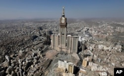 FILE - This Oct. 27, 2012 file aerial image made from a helicopter shows the Abraj Al-Bait Tower, also known as Makkah Royal Clock Tower Hotel