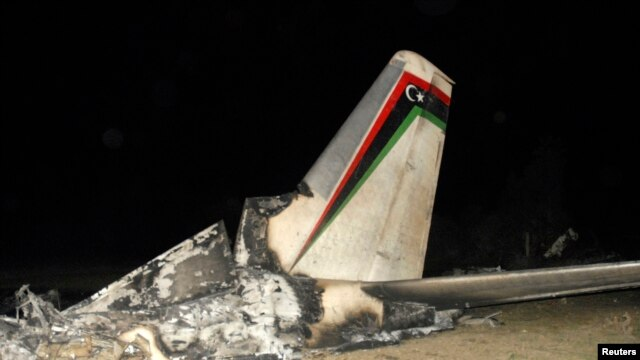 The wreckage of a Libyan military plane is seen in Grombalia town, south of Tunis, February 21, 2014.