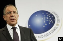 Russia's Foreign Minister Sergei Lavrov holds a news conference after a NATO-Russia foreign ministers meeting at the Alliance headquarters in Brussels, December 8, 2011.