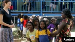 "FILE - Australian aboriginal school children line-up to receive free laptop computers as part of the ""One Laptop Per Child"" program in Elcho, Island May 27, 2009."