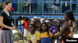 In this file photo, Australian aboriginal school children line up to receive free laptop computers in Elcho, Island May 27, 2009.