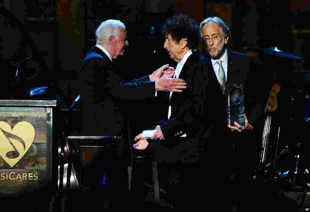President Jimmy Carter, left, presents Bob Dylan with the award for 2015 MusiCares Person of the Year at the Los Angeles Convention Center in Los Angeles, Feb. 6, 2015.