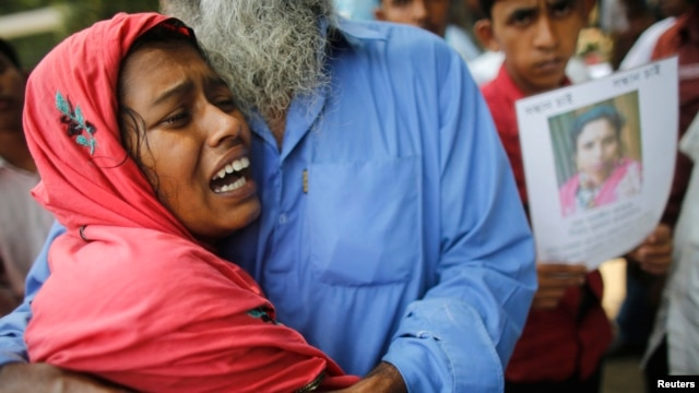 A woman mourns for her husband, a garment worker who had died in the collapse of the Rana Plaza building, in Savar, around 30 km (19 miles) outside Dhaka, Bangladesh, May 4, 2013.