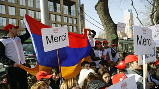 Activists of an Armenian youth group gather at the French Embassy in Yerevan to express their gratitude to France's parliament for passing a bill that outlaws denial of Armenian genocide, in Yerevan, Armenia, January 24, 2012