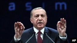 Turkey's President addresses police officers in Ankara, Turkey, Nov. 22, 2016. Turkey's government on Tuesday dismissed an additional 15,000 people from the military, police and the civil service as part of an ongoing investigation into the failed military coup in July.