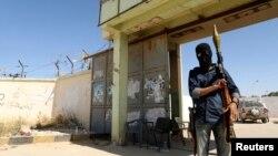 Un militant islamiste à Benghazi en Libye, le 16 mai 2014