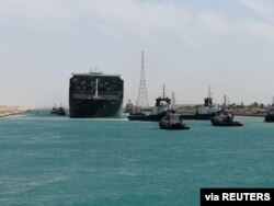 Ship Ever Given, one of the world's largest container ships, is seen after it was fully floated in Suez Canal, Egypt, March 29, 2021.