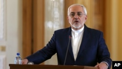 FILE - Iranian Foreign Minister Mohammad Javad Zarif speaks at a joint press conference with his French counterpart Jean-Marc Ayrault, in Tehran, Jan. 31, 2017. Zarif refused to confirm that the country conducted a missile test.