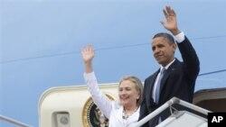 အေမရိကန္ သမၼတ Barack Obama ႏွင့္ ႏုိင္ငံျခားေရးဝန္ႀကီး Hillary Rodham Clinton ရန္ကုန္အျပည္ျပည္ဆုိင္ရာေလဆိပ္ကို ေရာက္ရွိလာစဥ္။