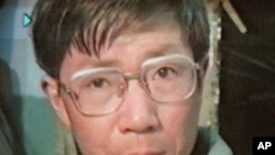 Veteran Chinese activist Qin Yongmin, shown in this April 1998 photo made off video while reading the declaration of a human rights group in Wuhan, will be put on trial for subversion of state power Thursday, Dec. 17, 1998 with another activist this week.