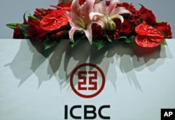 FILE - The company logo of the Industrial and Commercial Bank of China is seen during a news conference announcing its annual results, in Hong Kong, March 29, 2012.
