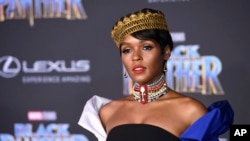 """FILE - In this Jan. 29, 2018 file photo, musician/actress Janella Monae arrives at the premiere of the film """"Black Panther,"""" at The Dolby Theatre in Los Angeles. Featuring a predominantly black cast, the film that is an ode to Africa - with costuming and sets heavily inspired by African cultures - moved many viewers, including cast members themselves, to dress in African-themed garments for their viewing the film."""