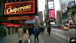 FILE - Time Square displays for musicals are among the lights of Broadway in New York, Nov. 29, 2007.