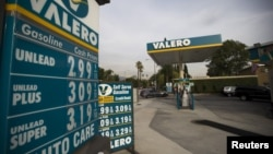 FILE - The prices at a Valero Energy Corp gas station are pictured in Pasadena, California, on Oct. 27, 2015.