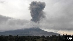 Mount Sinabung spews thick smoke in Karo, North Sumatra, Aug. 17, 2020. In addition to the volcano, two earthquakes struck off Indonesia's Sumatra island early Wednesday.